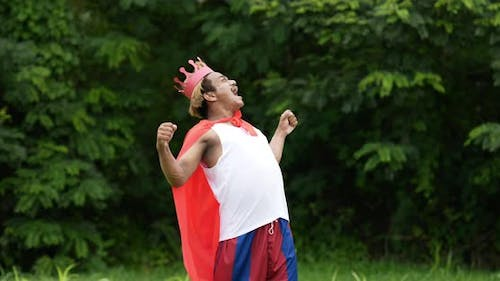 Hero man in red with crown roaring and standing