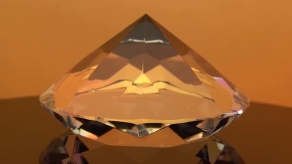 Thumbnail for Dear Diamond Is Spinning and Shimmering Orange Highlights. Orange Background