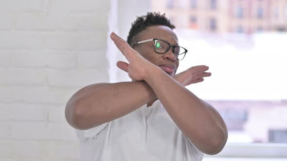 Thumbnail for Portrait of Casual African Man Saying No with Hand Gesture