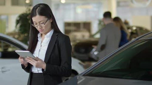Auto Saleswoman Posing