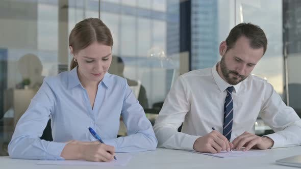 Thumbnail for Business People Writing Documents on Office Table