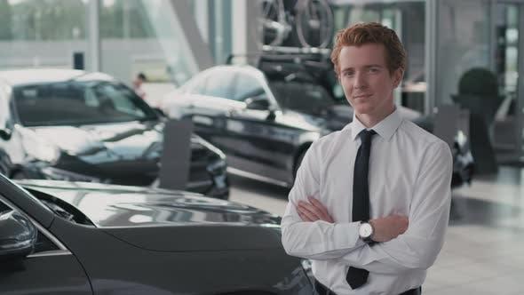 Thumbnail for Car Salesman Posing in Dealership