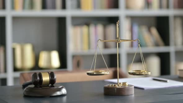 Thumbnail for Balance Scale and Gravel on Court Room Table