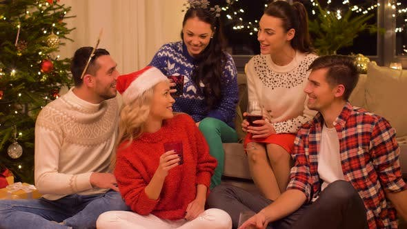 Thumbnail for Friends Celebrating Christmas and Drinking Wine