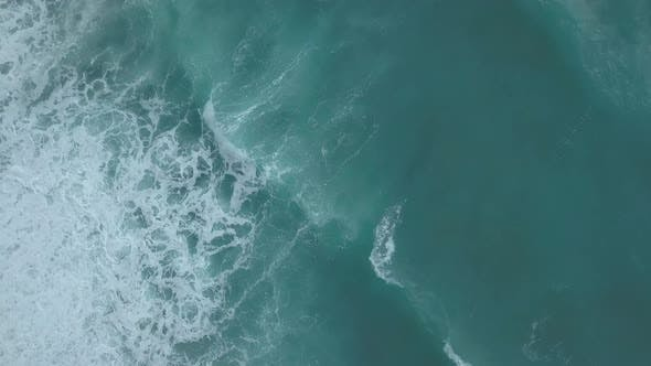 Thumbnail for Aerial Top View Turquoise Sea Waves Break on Empty Sand Beach. Clean Sea Waves From Bird's Eye View