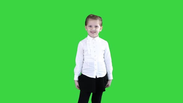 Thumbnail for Happy Cute Little Girl Walking in the Frame and Talking To Camera on a Green Screen, Chroma Key.