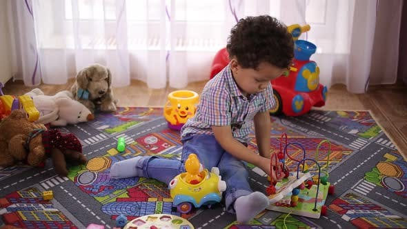 Thumbnail for Boy Playing With Toys