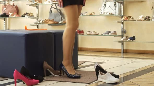 Thumbnail for Woman Tryes on Black and Brown Shoes