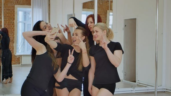 Thumbnail for Group of Young Women Taking a Selfie During a Pole Dance Class