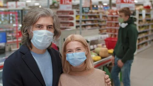 Portrait Of Customers In Disposable Masks