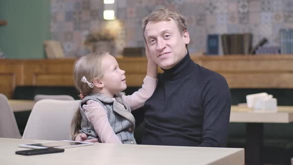 Thumbnail for Happy Single Father Talking with Cute Little Daughter in Restaurant
