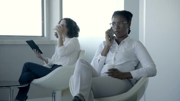 Thumbnail for Businesswomen with Digital Devices in Office