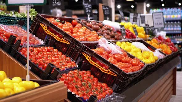 Thumbnail for Tomatoes and Other Fresh Vegetables with Price Tags on Supermarket Shelves