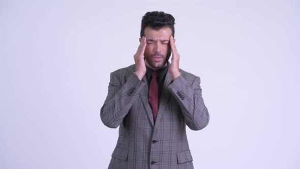 Cover Image for Stressed Bearded Persian Businessman Having Headache