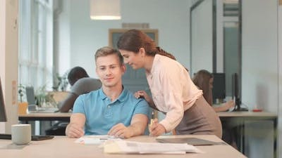 Business Woman Whispering Man Nice Things on Ear