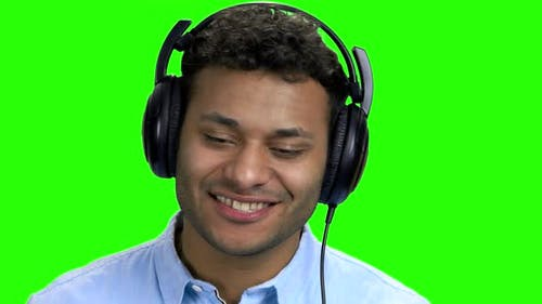 Close Up Happy Cheerful Man Listening Music in Headphones