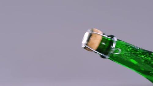 Man opening champagne bottle