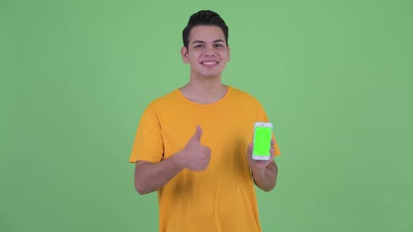 Thumbnail for Happy Young Multi Ethnic Man Showing Phone and Giving Thumbs Up
