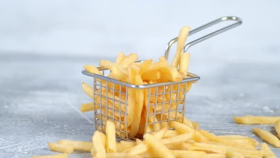 French Fries in the Basket Slowly Rotates.