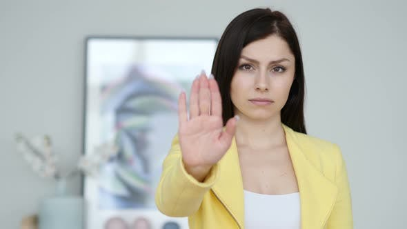 Thumbnail for Young Woman Gesturing Stop, Rejecting Invitation
