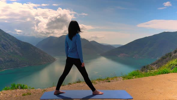 Thumbnail for Taut Woman Practicing Yoga Exercises on Mountain Top