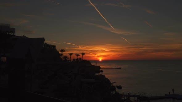 Thumbnail for Silhouette Of Shoreline At Sunrise