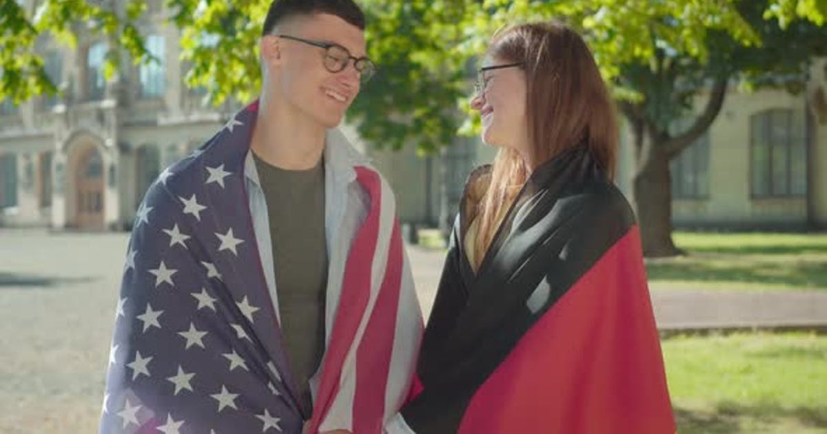 Portrait of Happy Intelligent German and American Students Posing on University Campus Yard. Young