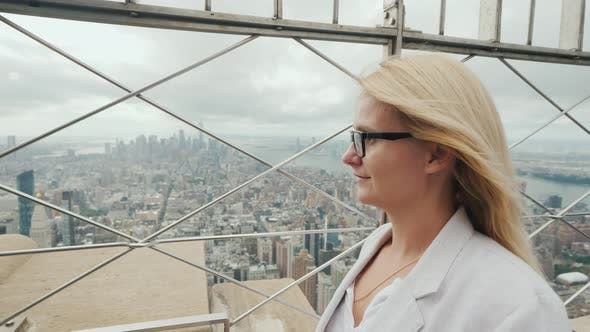 Thumbnail for Side View of a Woman Admiring New York City From a High Point