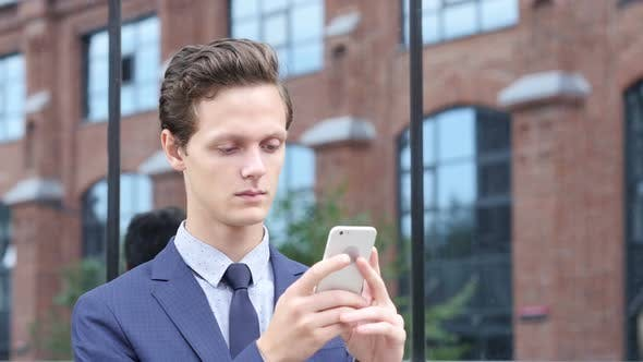 Thumbnail for Businessman Using Smartphone for Searching Information, Standing Outdoor