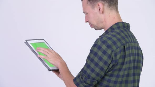Cover Image for Profile View of Hipster Man Using Digital Tablet