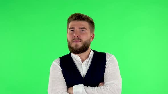 Thumbnail for Man Listens Carefully To Boring Information and Looks Around on Green Screen