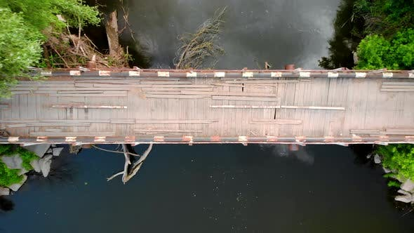 Drone Shot of Old Emergency Bridge Over Small River, Dangerous