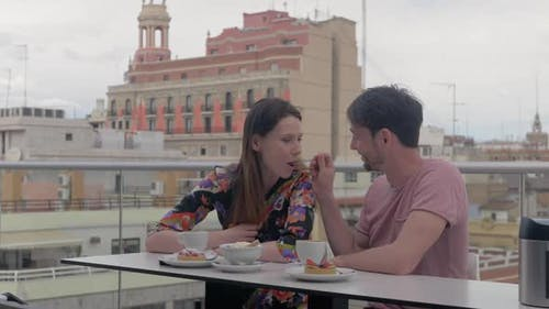 A Couple Enjoying Coffee and Desserts in a Rooftop Cafe in Valencia