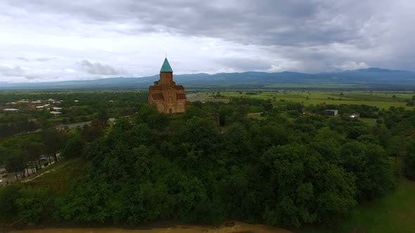 Thumbnail for Drone Flying Over Old Georgian Gremi Church Standing on Green Hill, Architecture