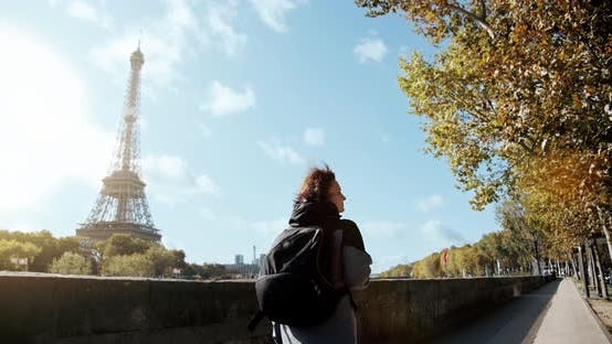 Thumbnail for Tourist Girl with A Backpack Walks the City of Paris, Past the Eiffel Tower and The Seine River, And