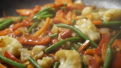 Close Up Chef Cooking Vegetables in Pan