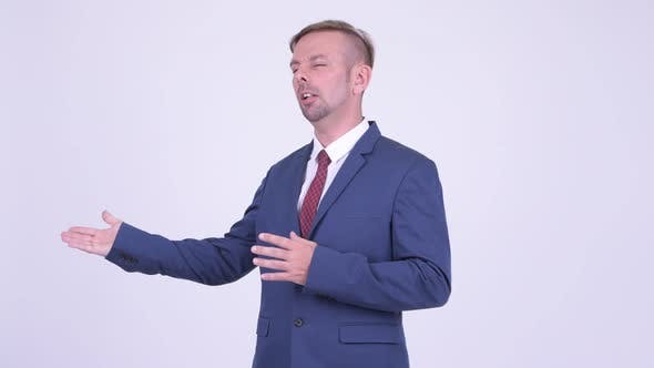 Cover Image for Portrait of Blonde Businessman Presenting Something