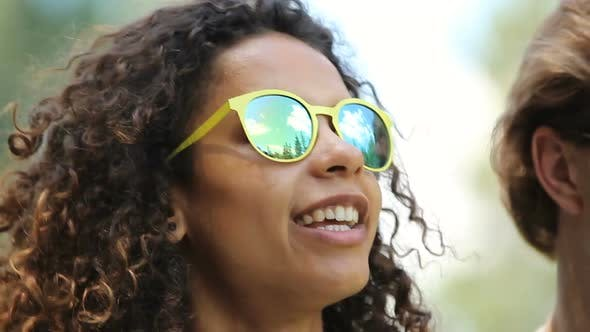 Thumbnail for Attractive Biracial Girl in Yellow Sunglasses Dancing, Singing Among Friends