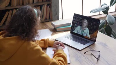 Smiling Hispanic Woman School Teacher Virtual Teaching By Zoom Conference Call
