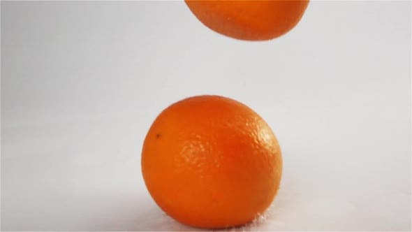 Thumbnail for Oranges Falling and Bouncing at White Wet Surface