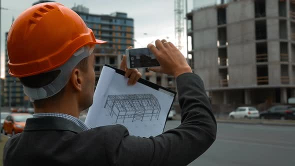 Thumbnail for Engineer with the Smart Phone Taking Pictures of Construction