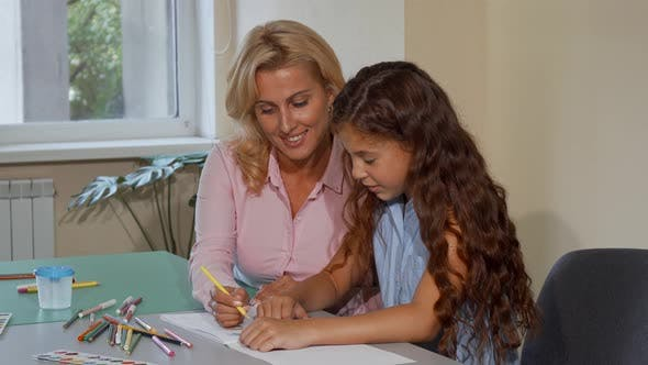 Thumbnail for Mature Female Teacher Enjoying Working with Her Little Student at School