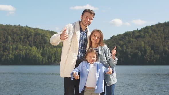 Thumbnail for Portrait of a Young Family on the Background of a Lake