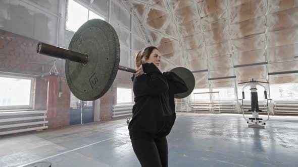 Thumbnail for Athletic Girl Doing Barbell Lunges