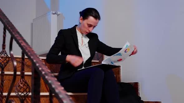 Businesswoman Reading Financial Raport of Deadline