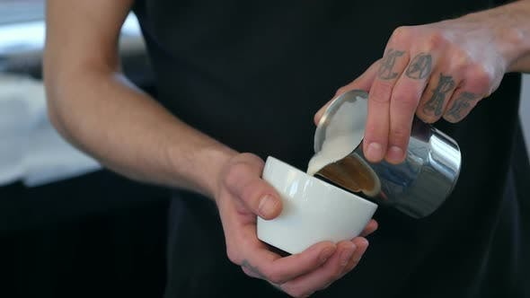 Thumbnail for Barista Making Coffee, Pouring Milk Into a Cup
