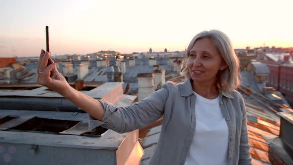 Thumbnail for Grey-haired Middle-aged Woman Making Selfie on Roof