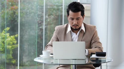 young business man using laptop computer
