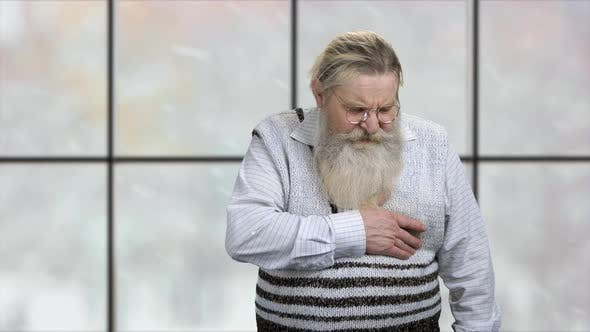Portrait of Old Caucasian Man Suffering From Chest Pain