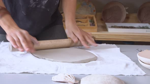 Thumbnail for Woman Rolling Clay Craftsman Skill Concept
